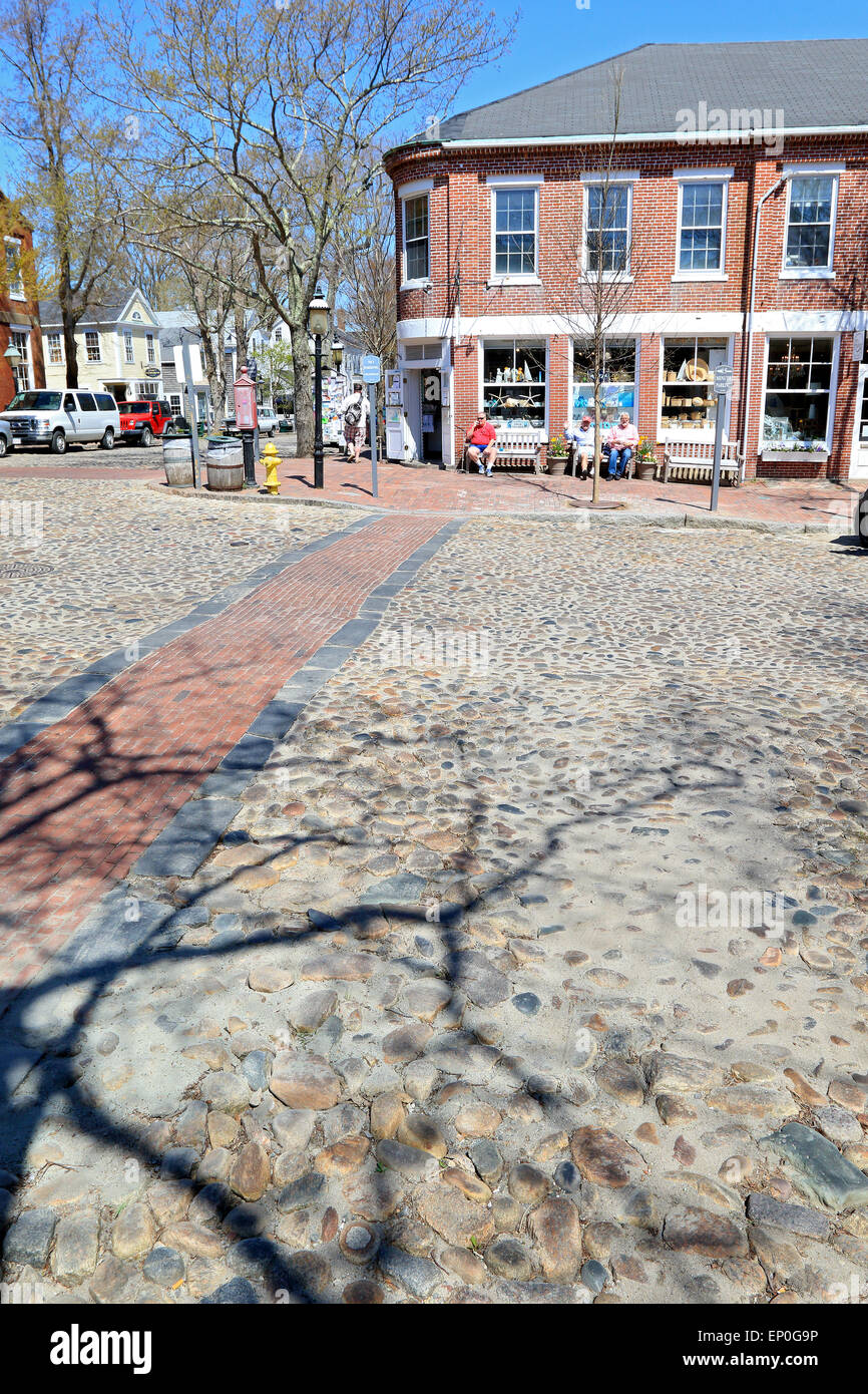 Nantucket Massachusetts on Nantucket Island. Crosswalk at the centre, center of town with cobbled street intersection. - Stock Image