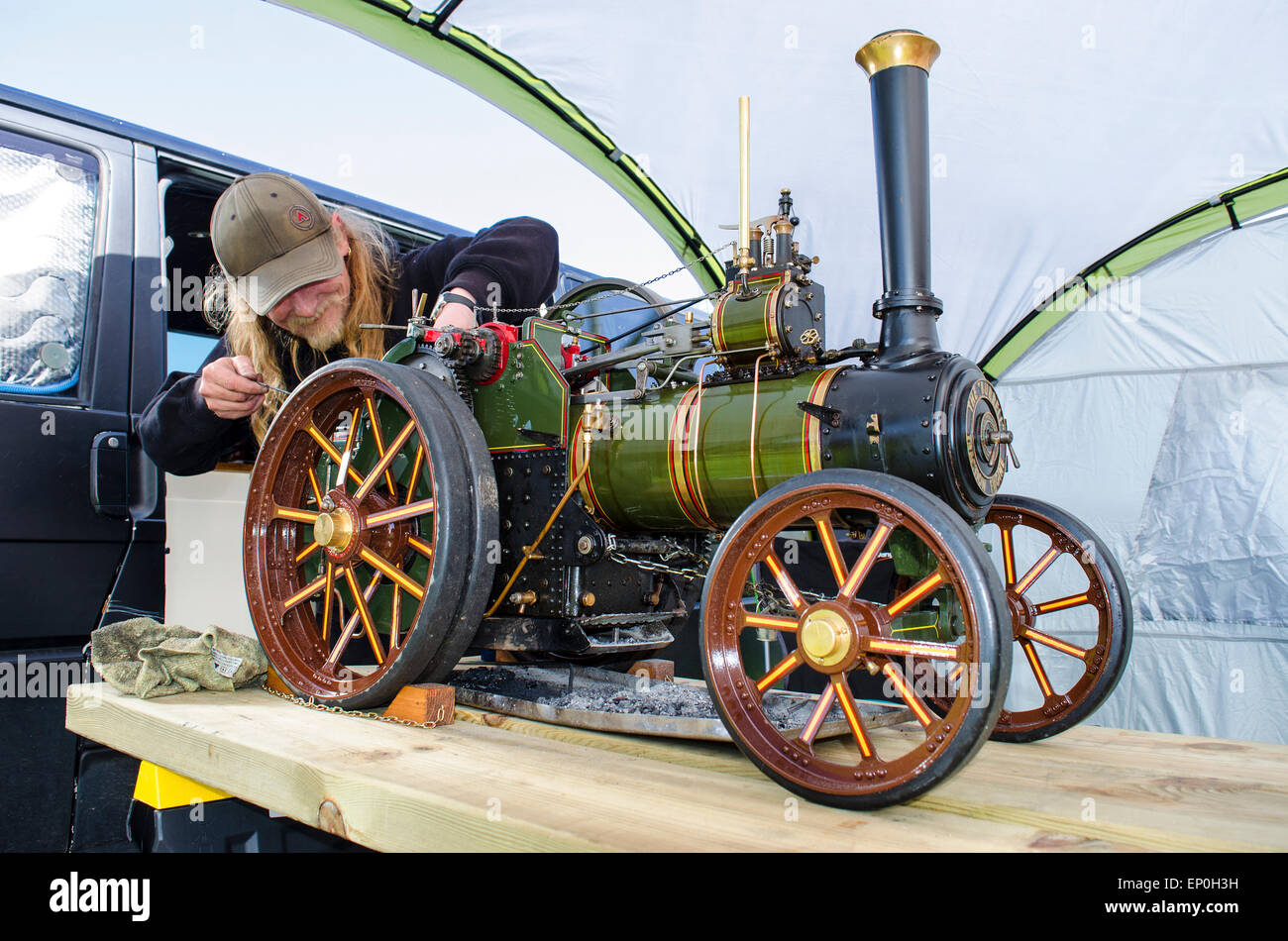 an enthusiast with a miniature steam engine - Stock Image