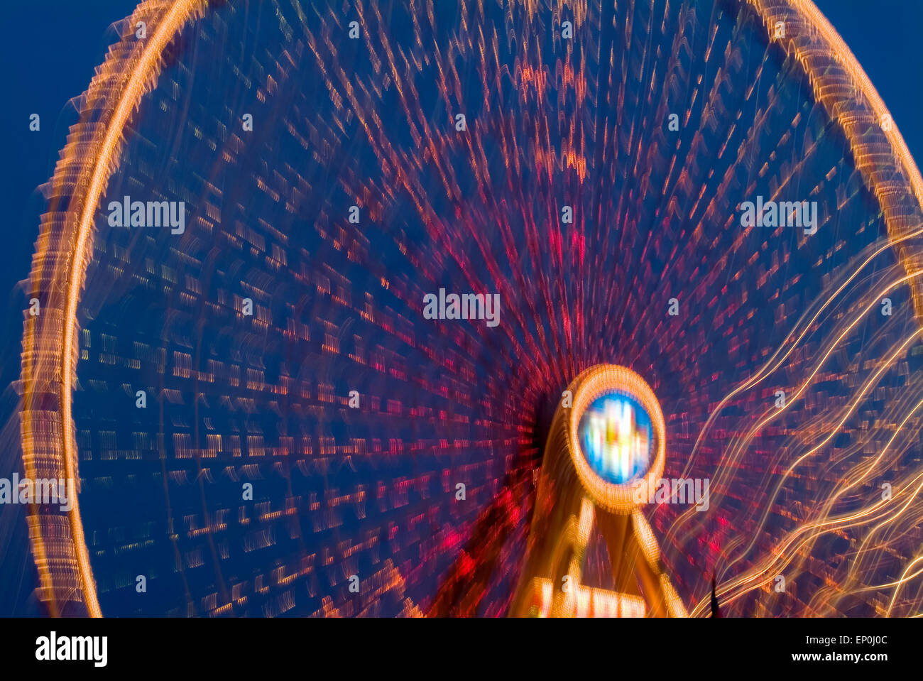 Big wheel on a funfair in motion giant Ferry germany europe - Stock Image