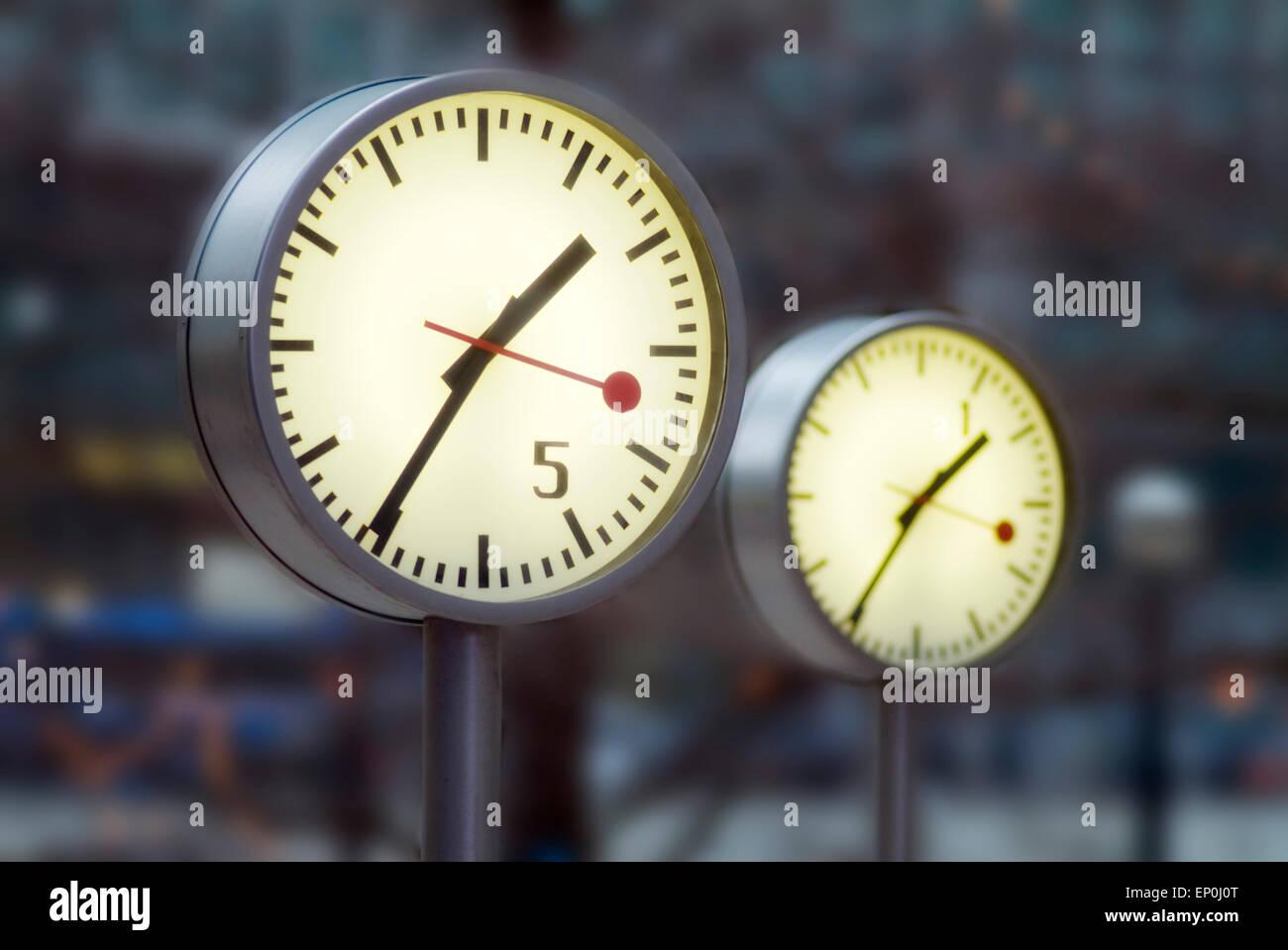 Clocks in Canary wharf, London, GB, Europe - Stock Image