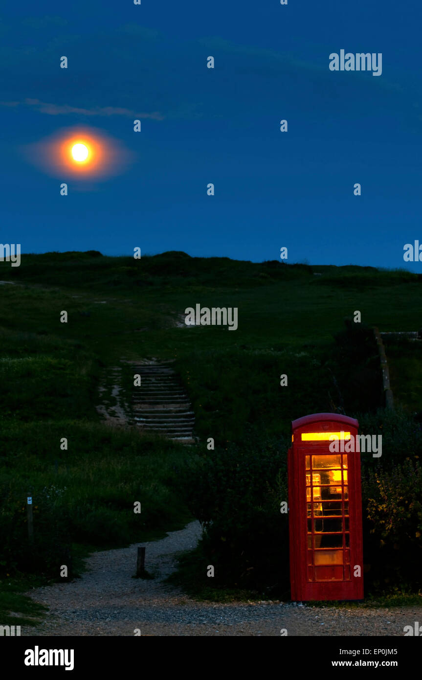 Telephone box and full moon in south england, great britain, europe - Stock Image