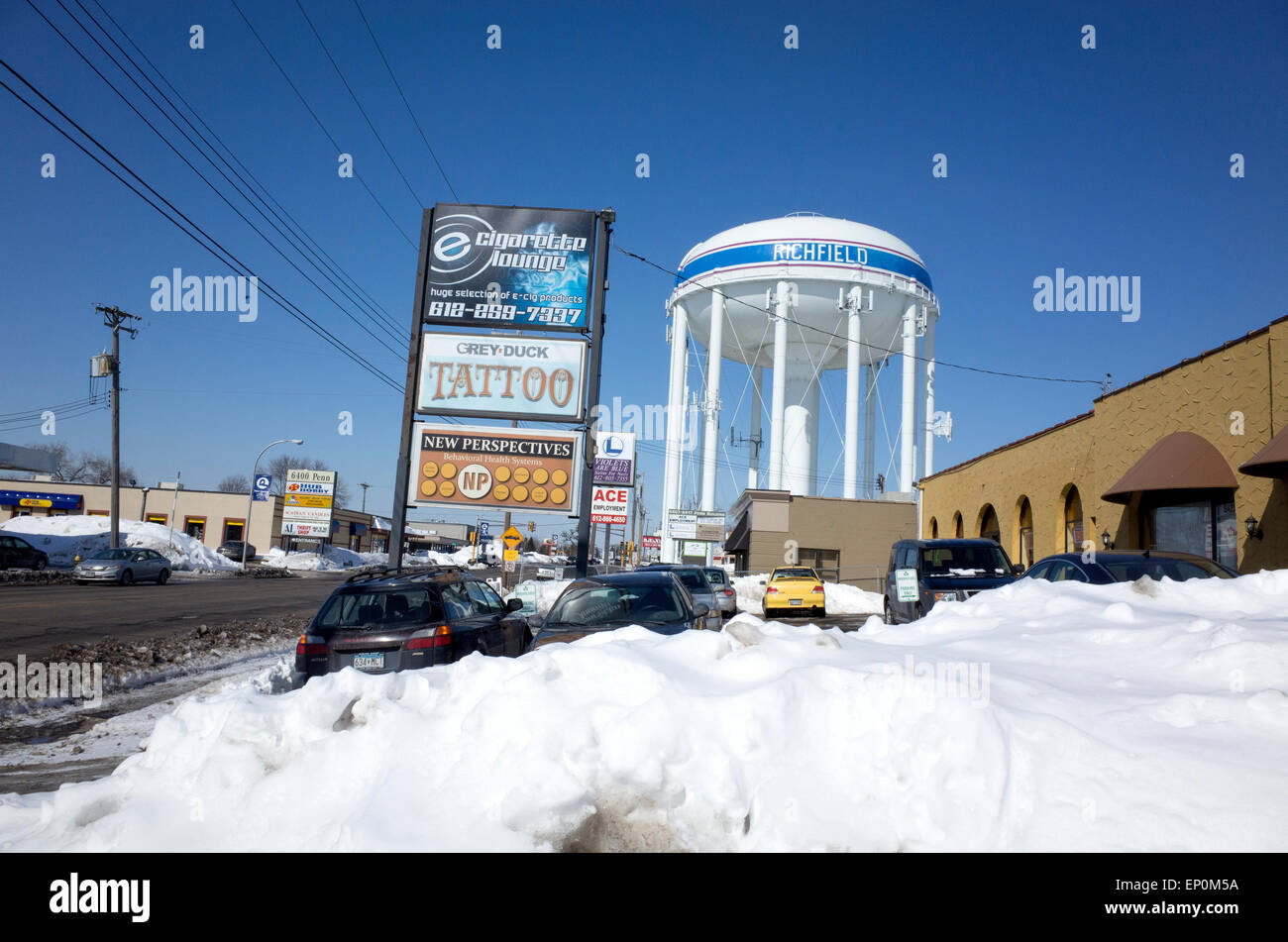 Penn Avenue bordered by a plethora of shops and the city water tower. Richfield Minnesota MN USA - Stock Image