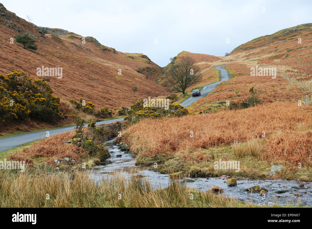 Car driving uphill in Lake District, UK - Stock Image