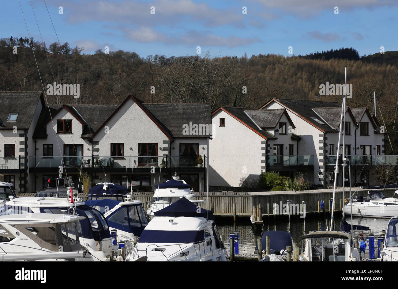 Boats and houses in Windermere marina village in Lake District, UK Stock Photo