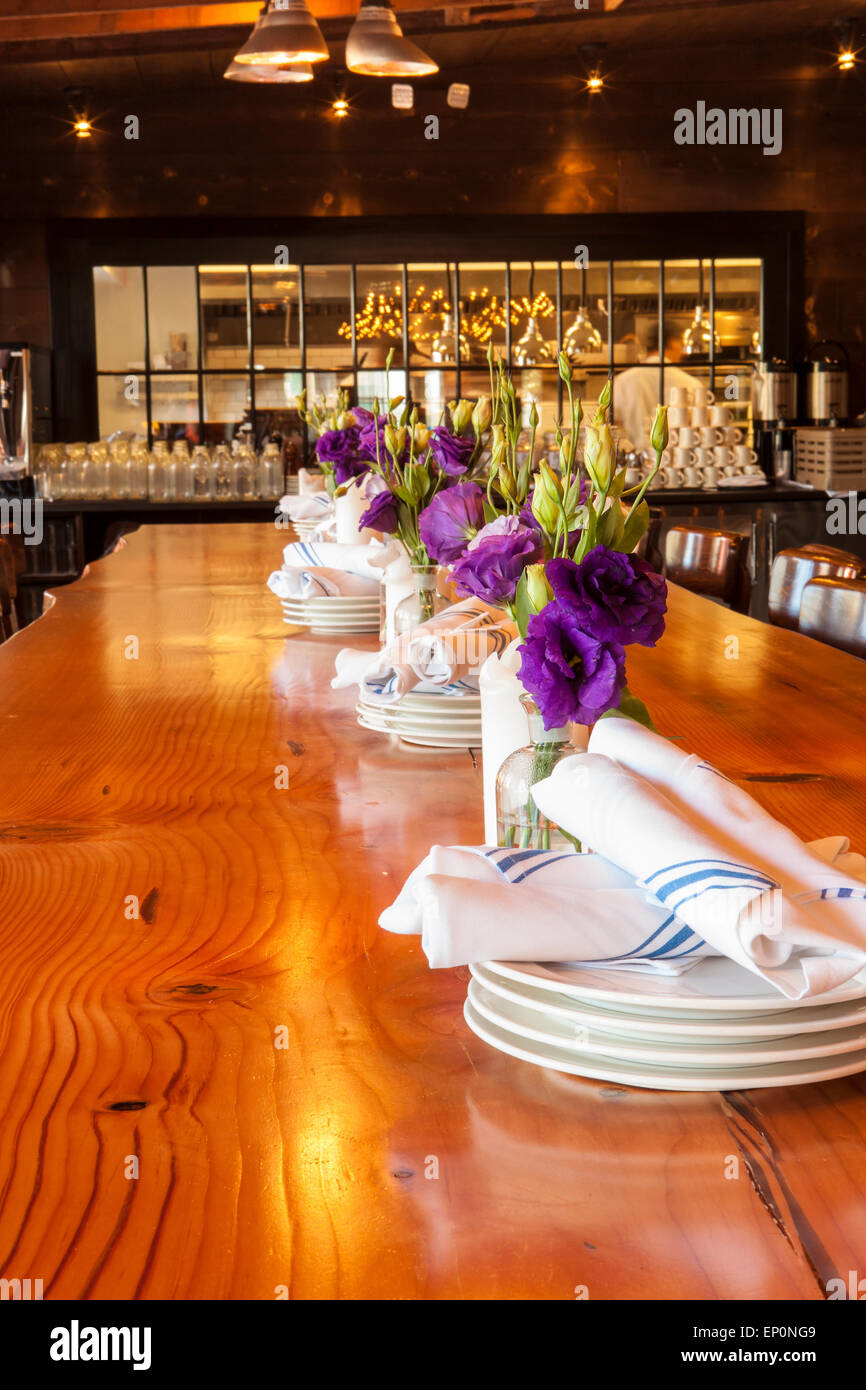 communal table with kitchen in background, The Lark in the Funk Zone, Santa Barbara, California, United States of - Stock Image