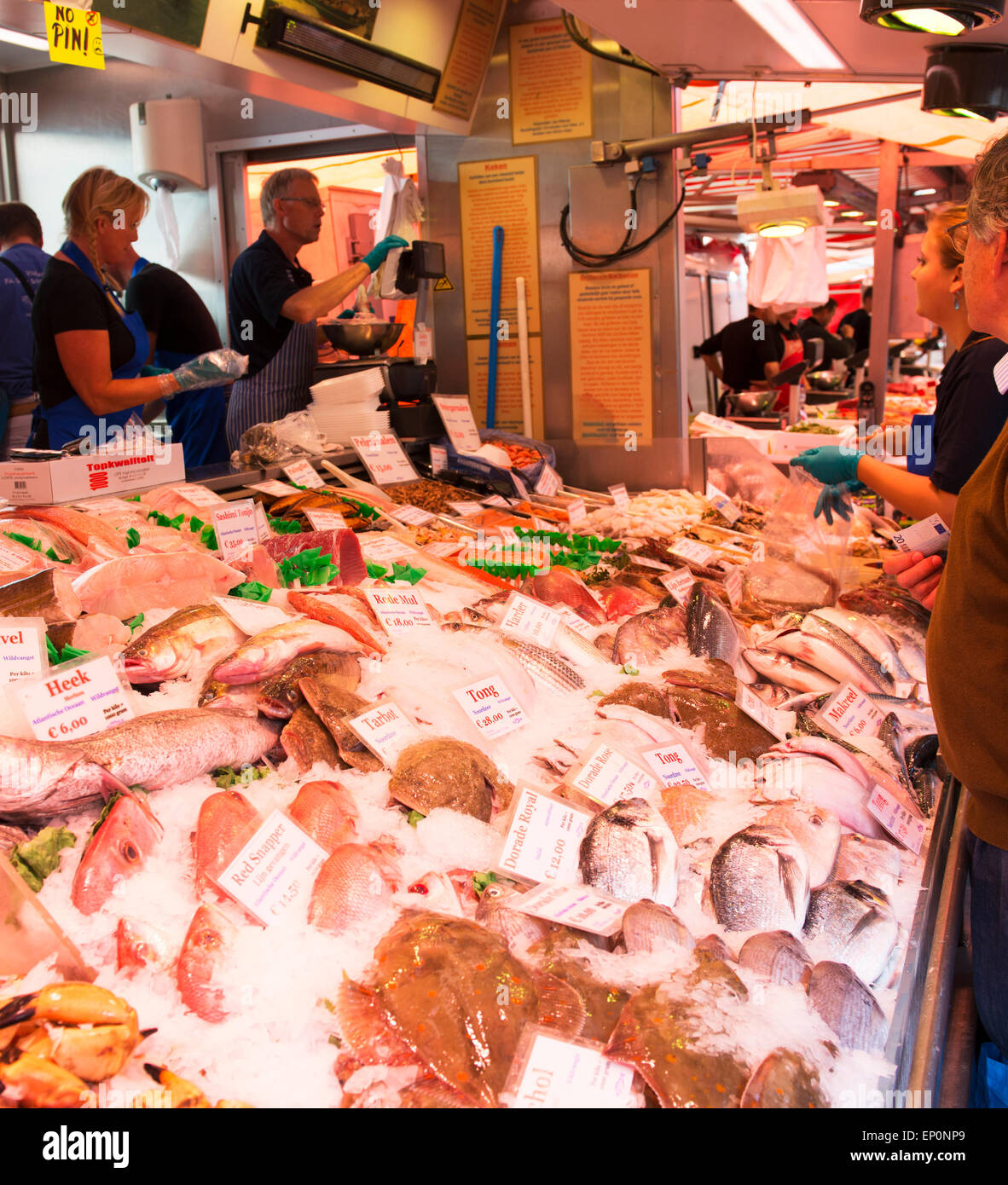 Buyers, sellers and fish at Amsterdam's Fish Market. - Stock Image