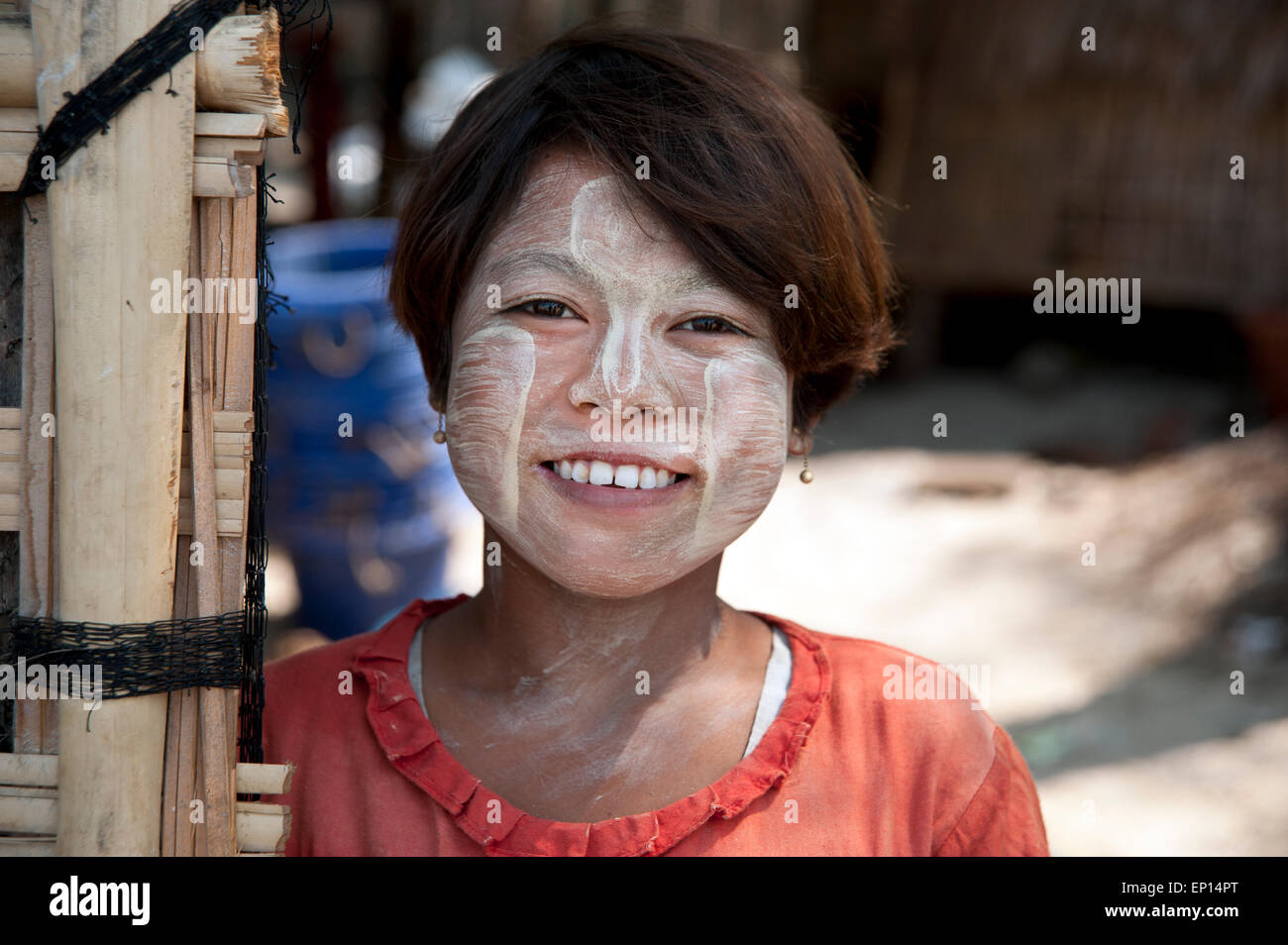 A portrait of a happy smiling young Burmese girl with sandalwood