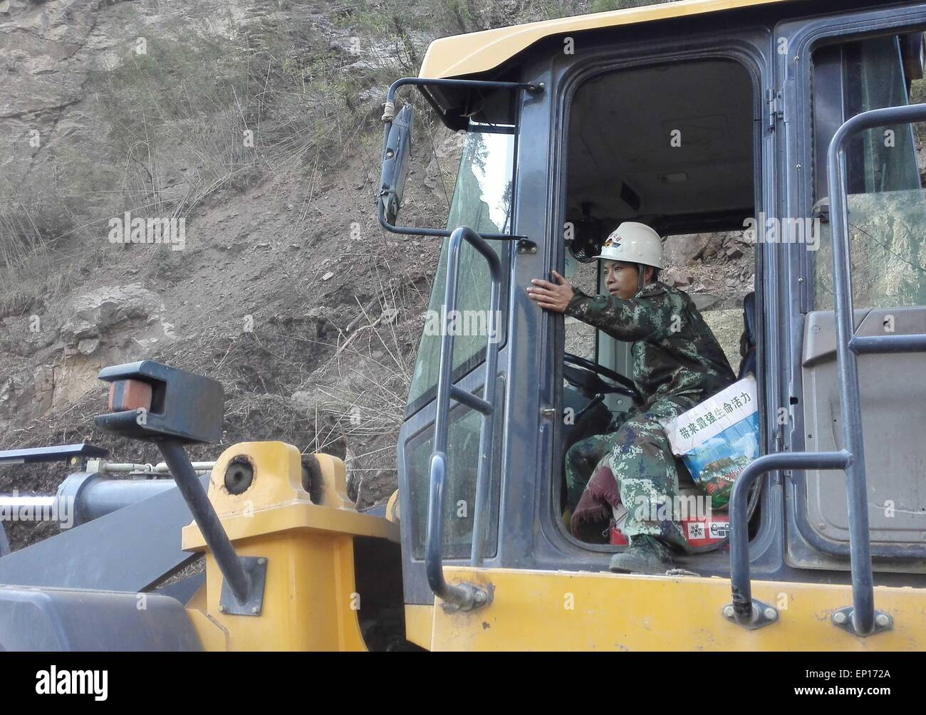 Gyirong, China's Tibet Autonomous Region. 13th May, 2015. A soldier driver retreats after a sudden landslide - Stock Image