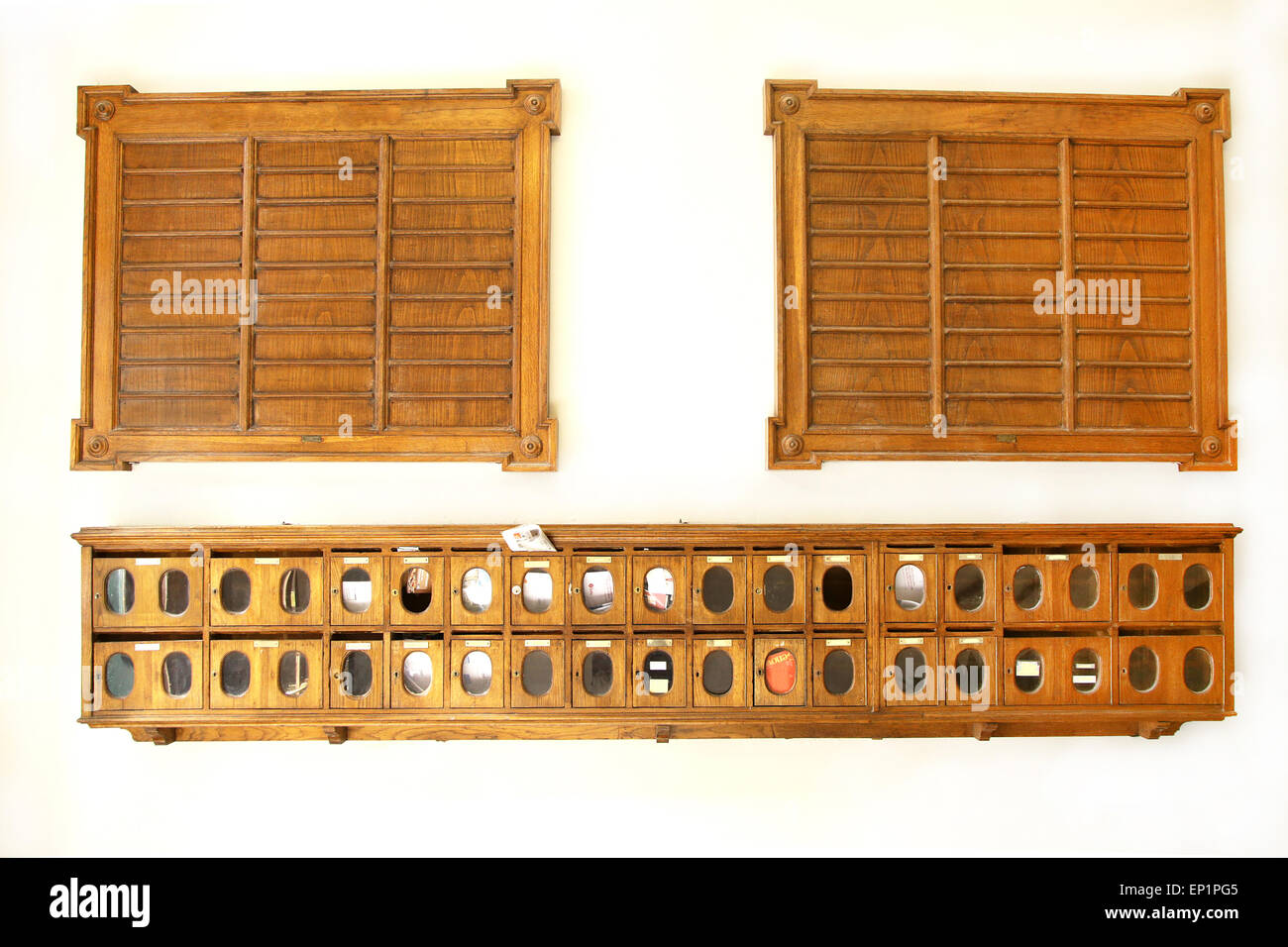 vintage wooden mailboxes and board for apartments and tenants list - Stock Image
