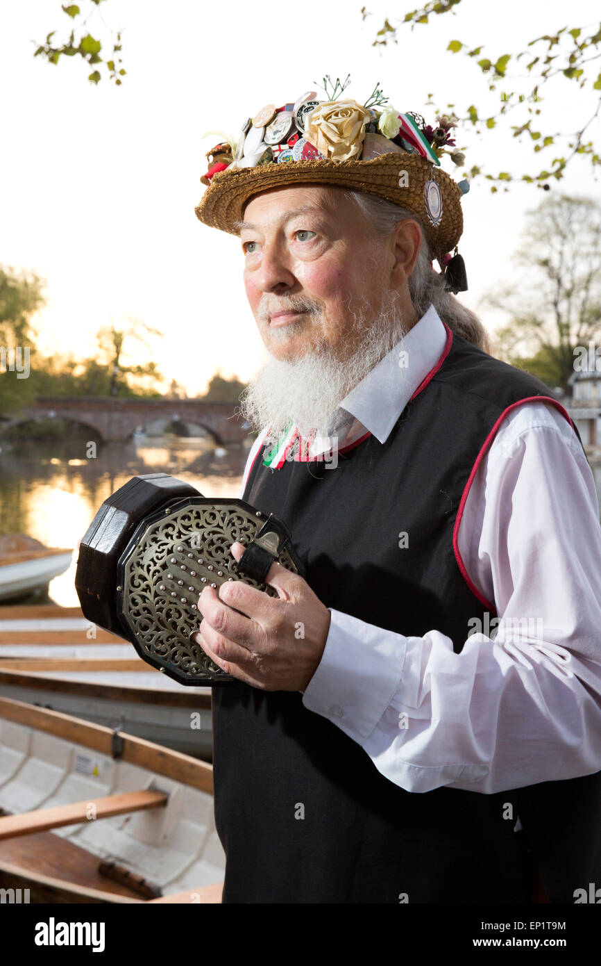 Alan Whitbread playing a English Concertina beside the River Avon. Alan is a member of the Shakespeare Mummers and - Stock Image