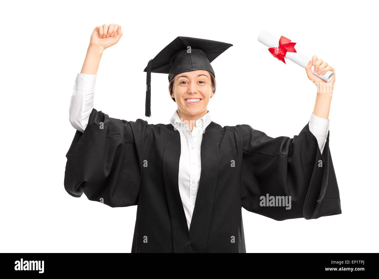 Joyful female graduate student in black gown holding a diploma and ...