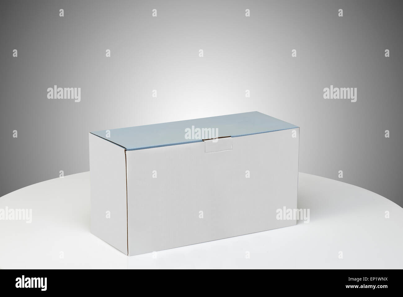 Real Cardboard box closed ready for packaging and delivering - Stock Image