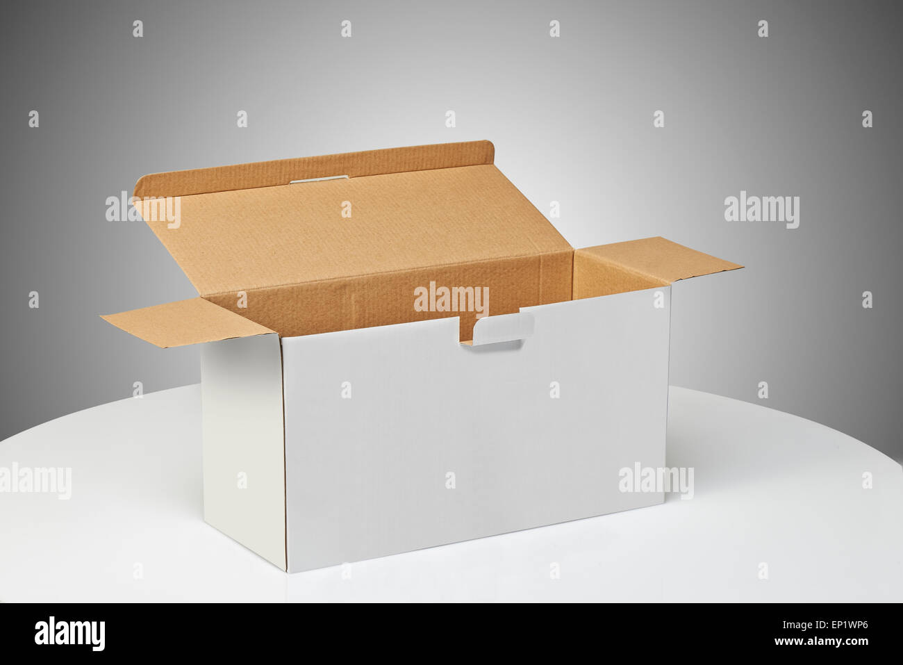 Real Cardboard box opened ready for packaging and delivering - Stock Image
