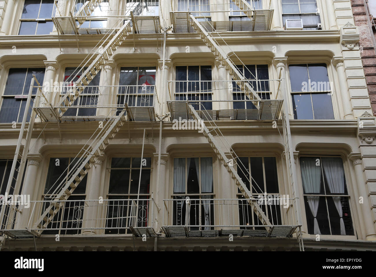 United States. New York City. Lower Manhattan. Soho. Common-style fire escapes. - Stock Image