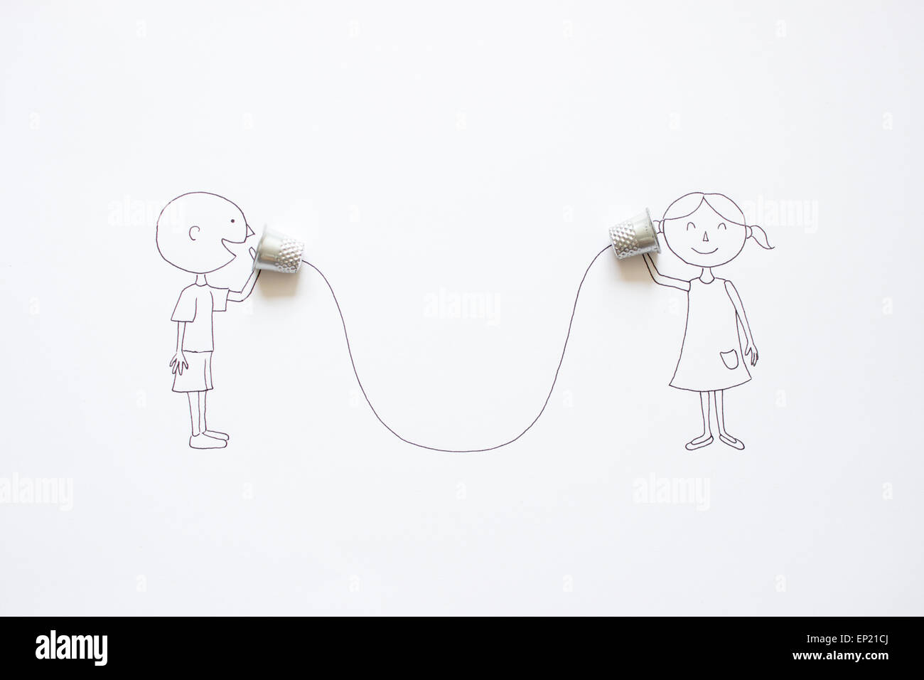 Conceptual boy and girl talking with tin can phones - Stock Image