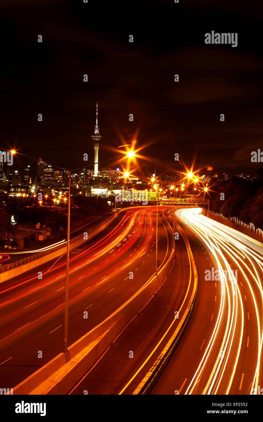 Northern Motorway and Skytower at night, Auckland, North Island, New Zealand Stock Photo