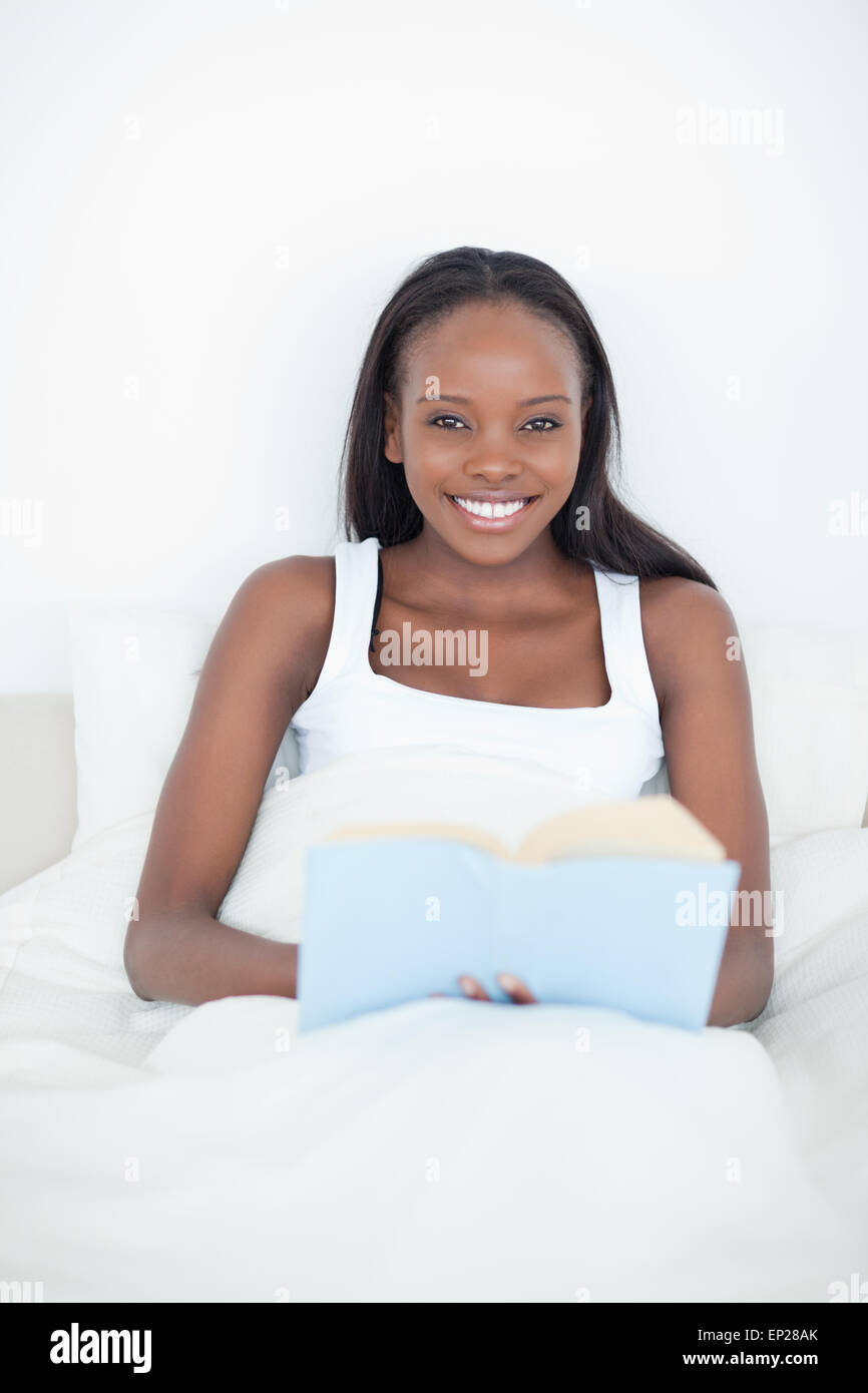 Portrait Of A Young Woman Holding A Book Stock Photo