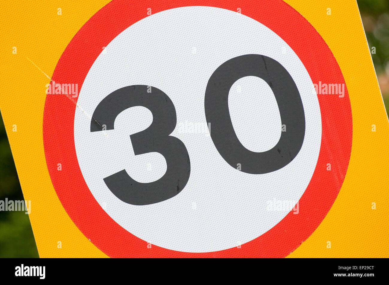 30 mph miles per hour thirty speed limit limits speeding restrictions restricted urban road roads road sign signs - Stock Image