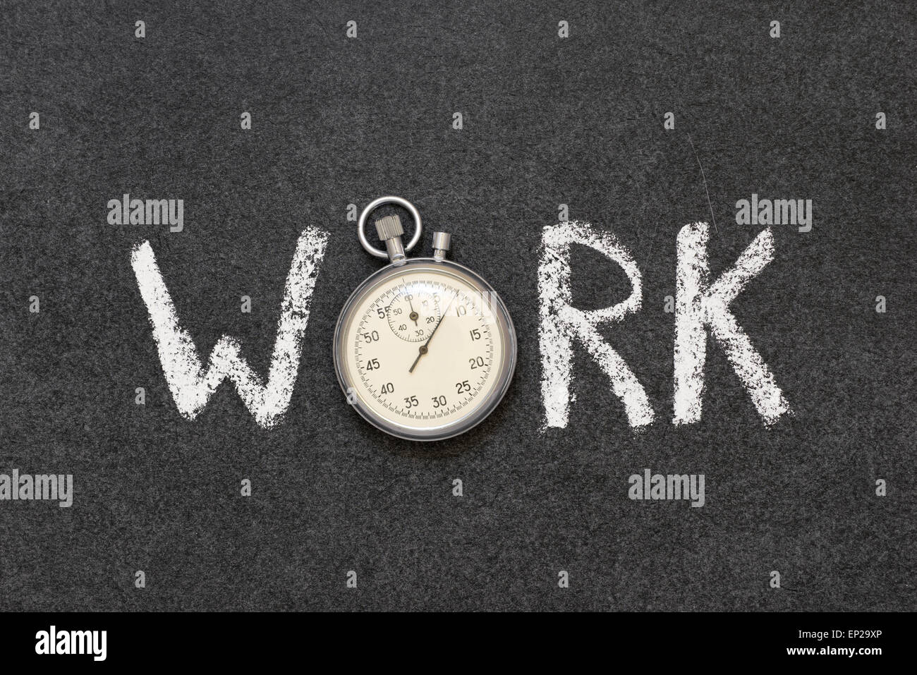 work word handwritten on chalkboard with vintage precise stopwatch used instead of O - Stock Image