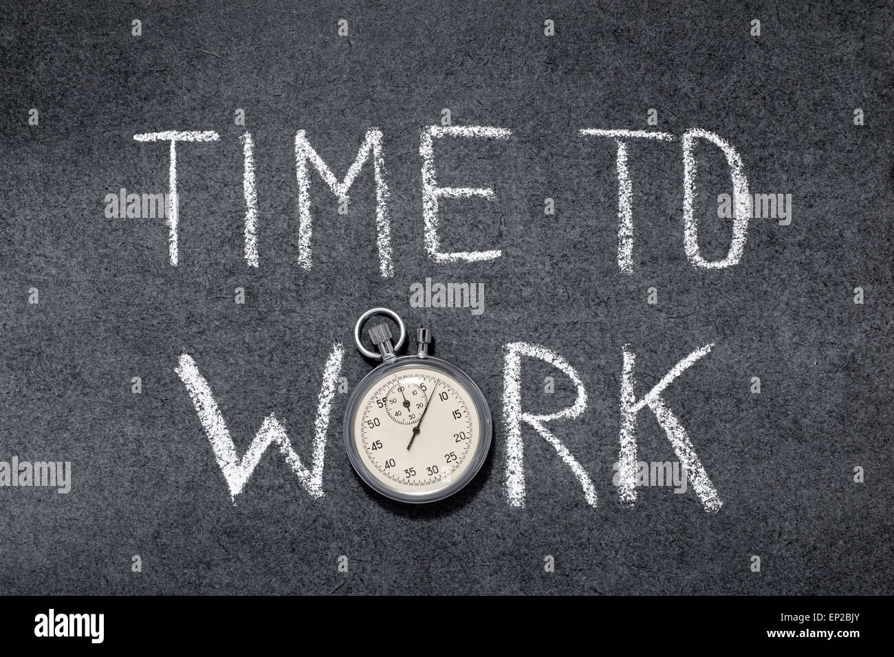 time to work phrase handwritten on chalkboard with vintage precise stopwatch used instead of O - Stock Image