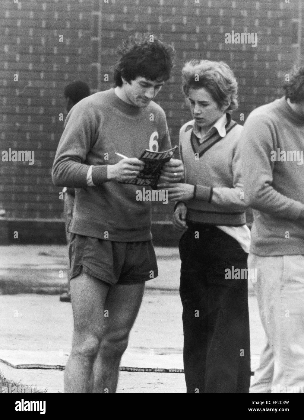 Dennis Mortimer signs his autograph for a fan at Villa Park. 12th April 1976. - Stock Image