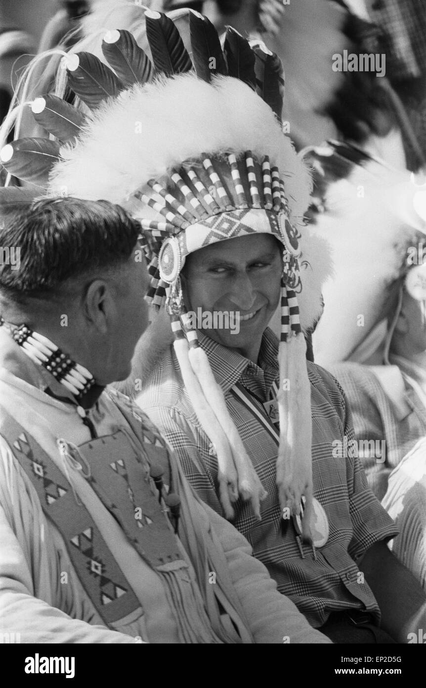Prince Charles, the Prince of Wales, made a Kainai Blood Indian Chief, wearing Indian headdress as he talks with - Stock Image