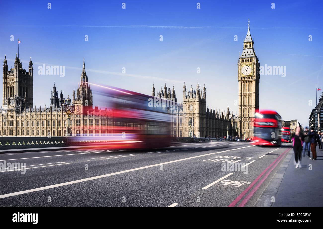 London, the UK. Red bus in motion and Big Ben, the Palace of Westminster. The icons of England in vintage, retro - Stock Image