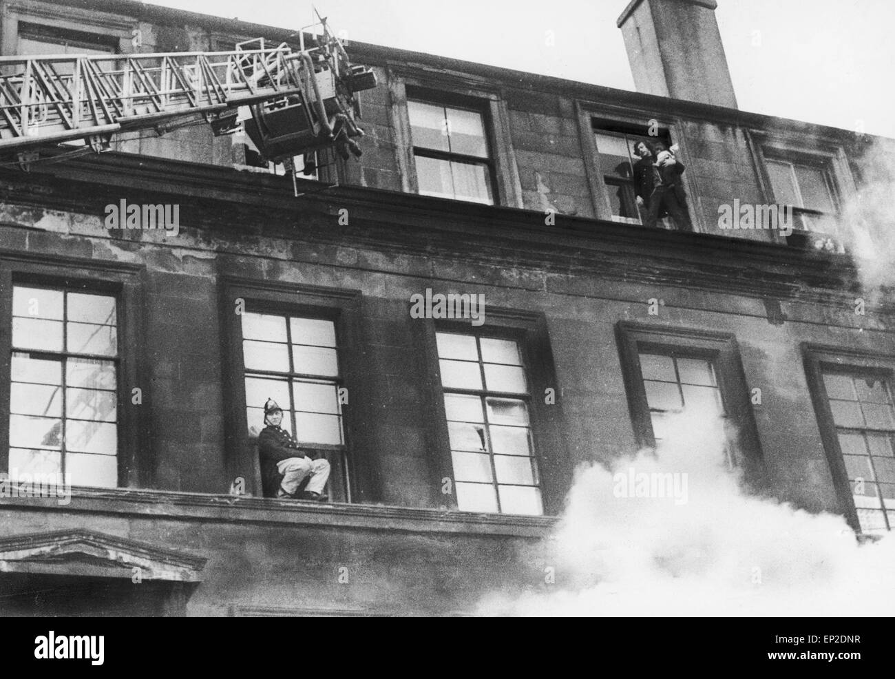 Fire at Maryhill Road Glasgow. Fire breaks out in an unoccupied furniture shop spreading along the row of shops - Stock Image