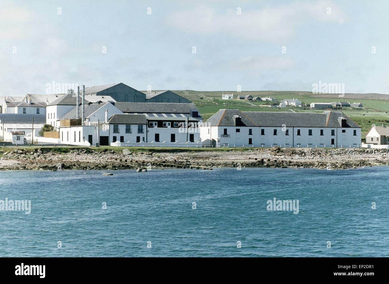 Bruichladdich Distillery on Islay, which is no longer used. - Stock Image