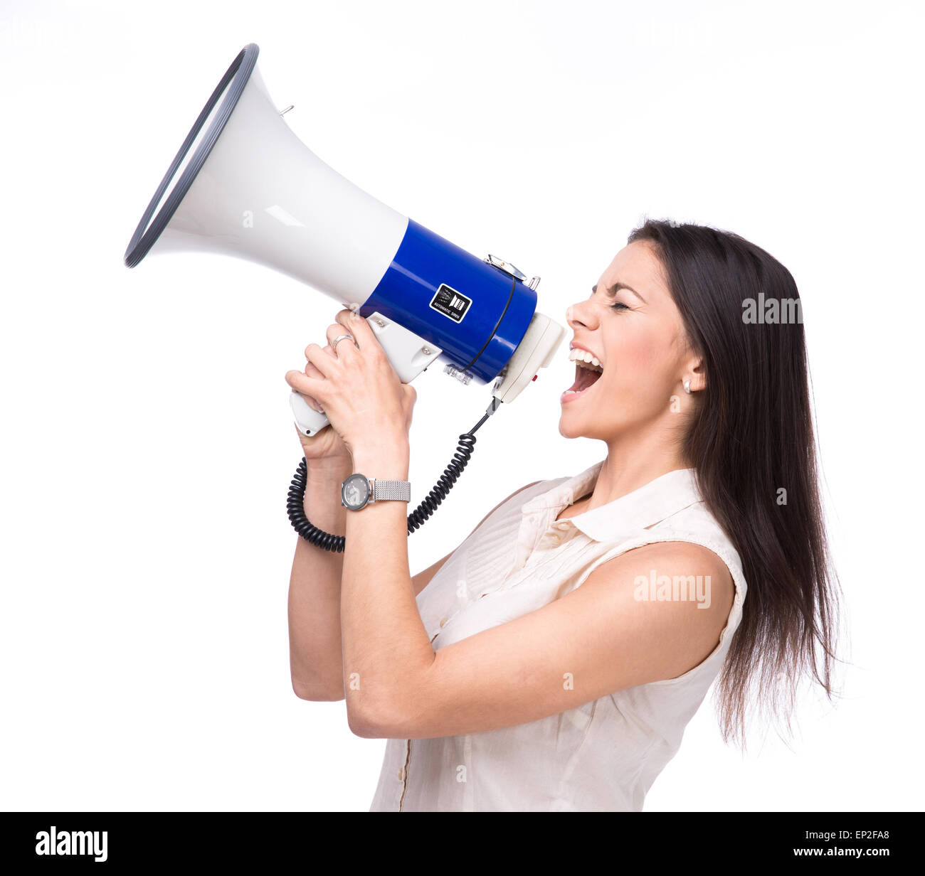 Businesswoman shouting in loudspeaker isolated on a white background - Stock Image