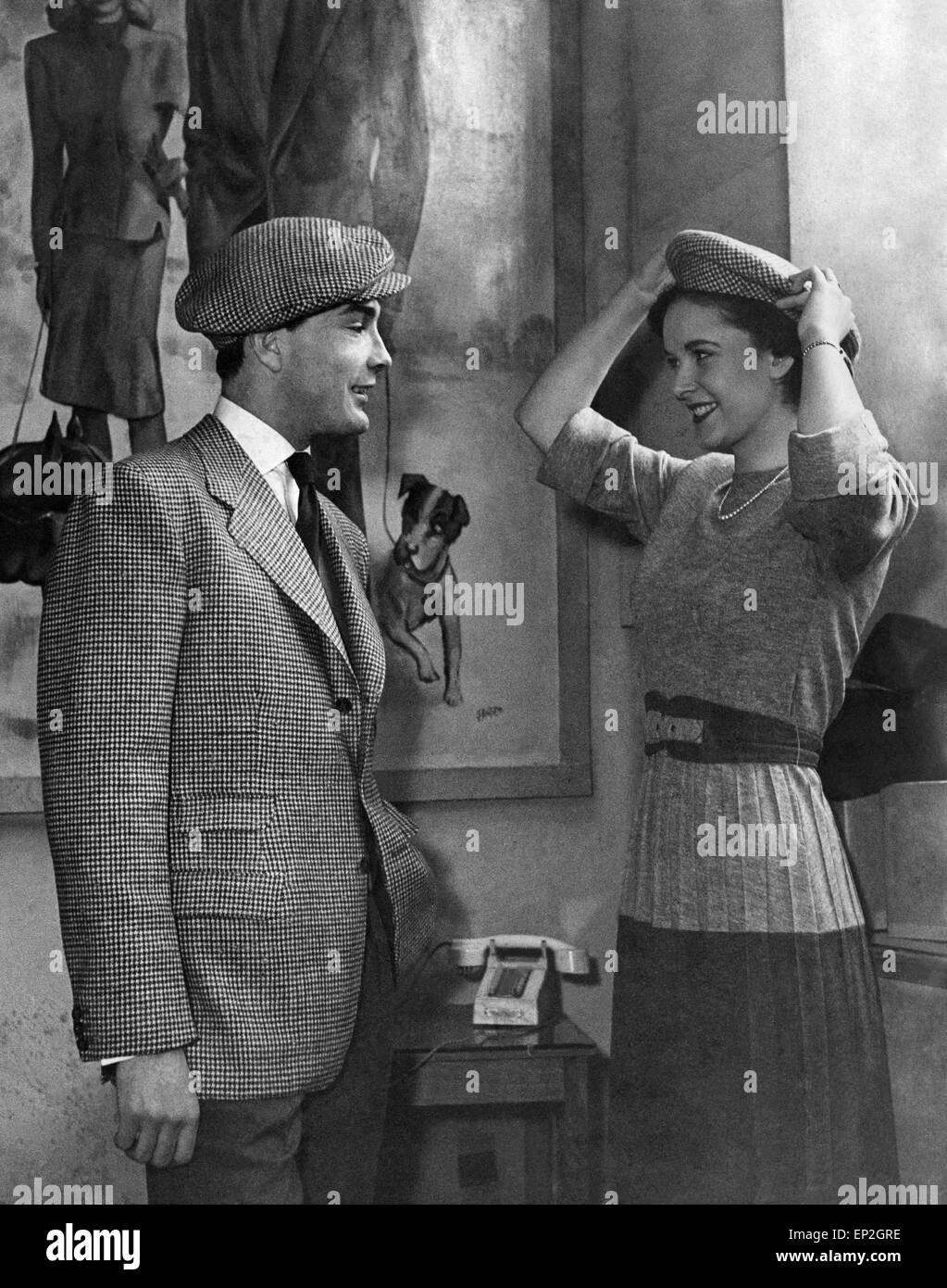 Clothing Fashion 1940s. Man Wears Hat. Models, Gayna Bright 17, and John Kylie, wearing tweed hats. - Stock Image