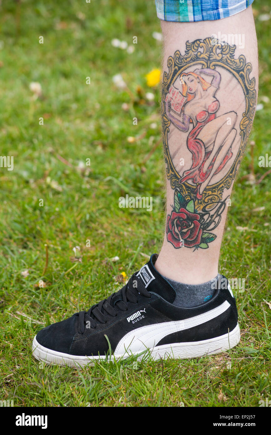 6cd26924a Tattoo of Jessica from Who Framed Roger Rabbit on man's leg with red rose -  Stock