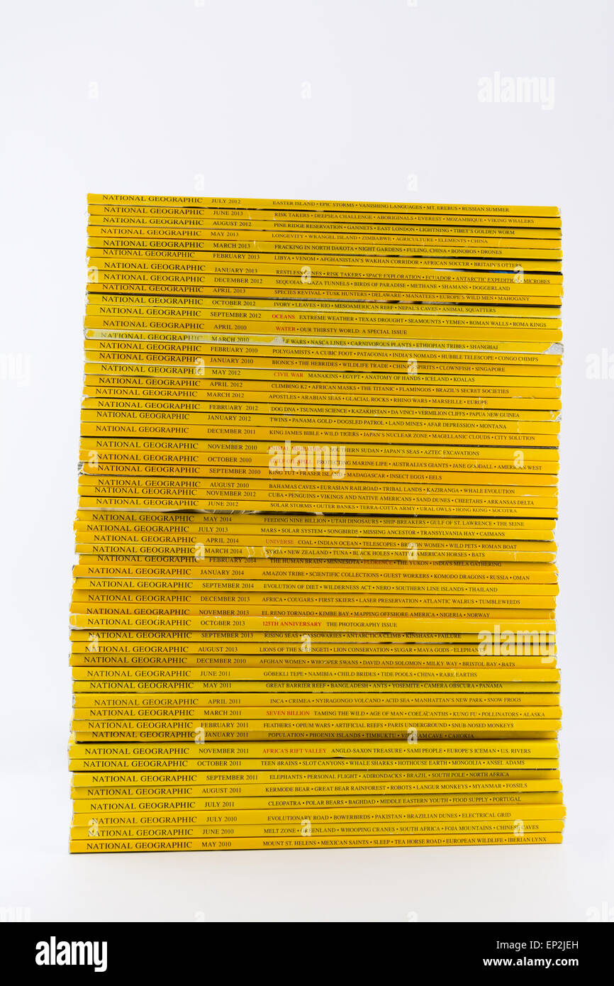 Stack of National Geographic magazines against a white background - Stock Image