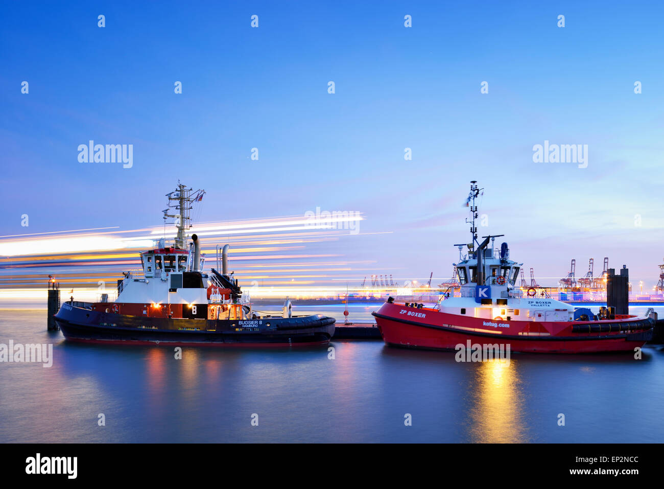 Germany, Hamburg, harbor with tugboats at blue hour - Stock Image