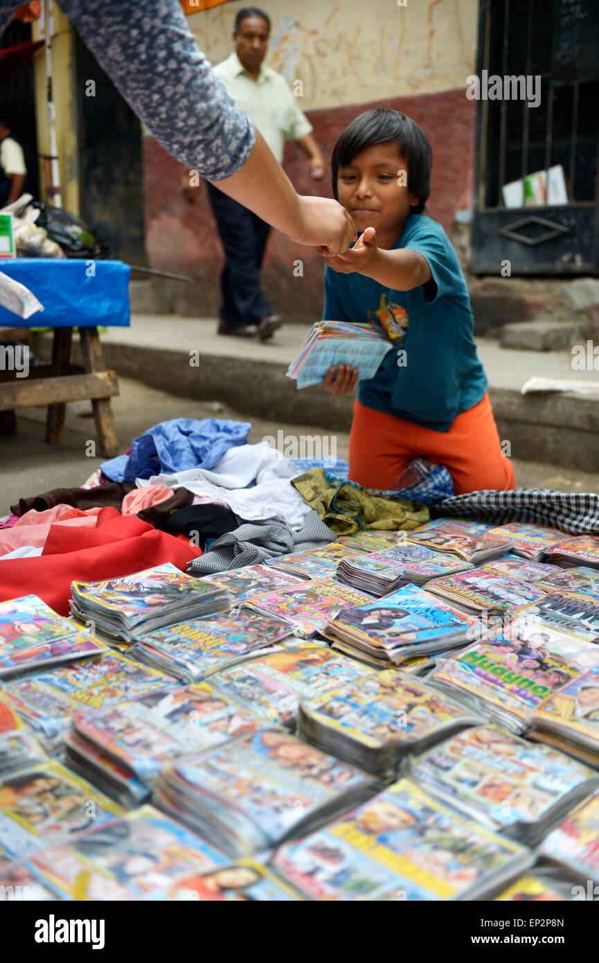 Peru, Lima, boy selling pirate copies of movies - Stock Image