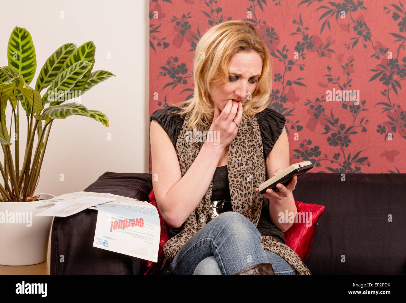 Young woman concerned about bills - Stock Image