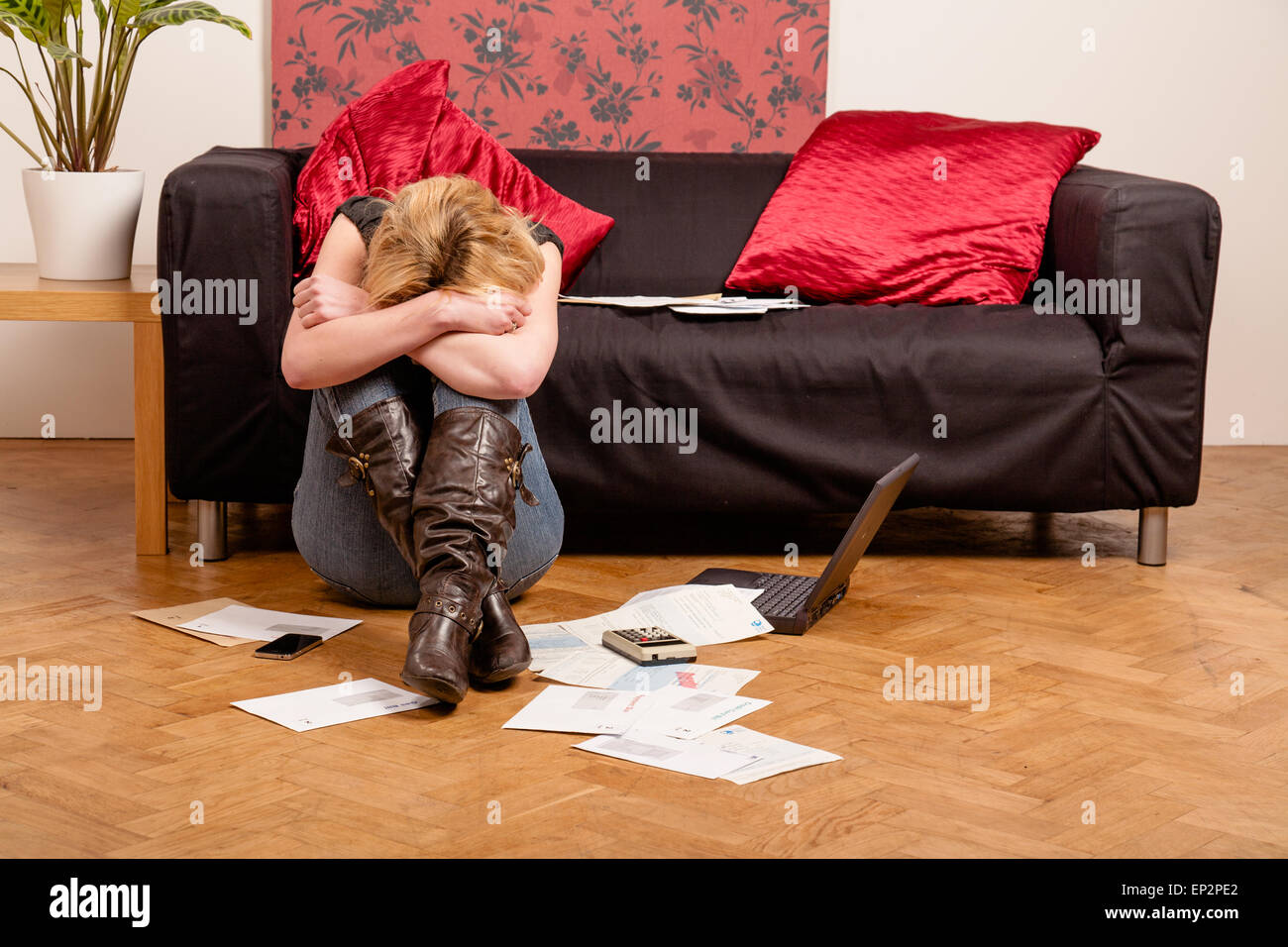 Young woman worried about her debts - Stock Image