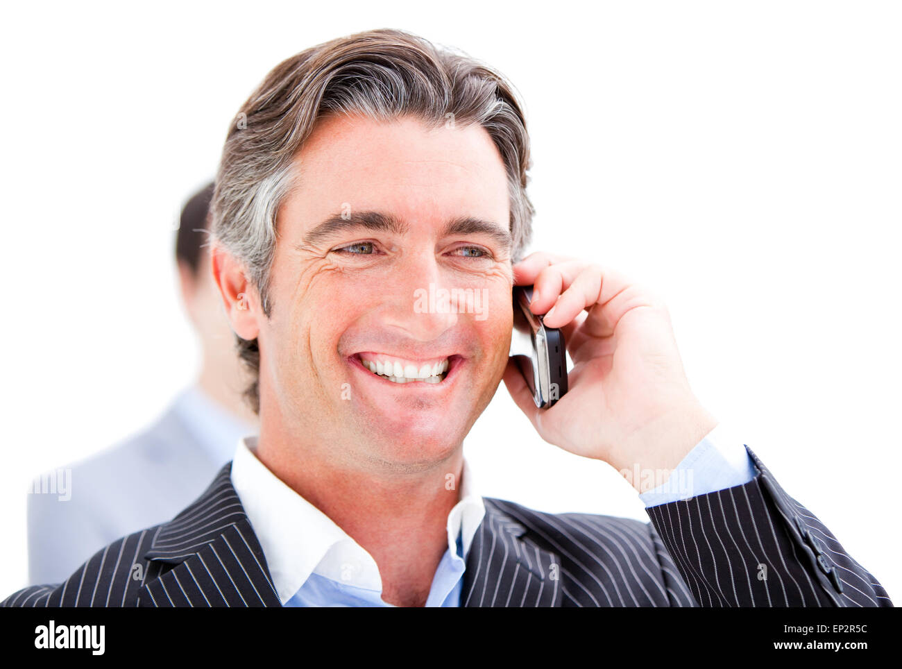 Happy businessman talking on the phone against a white background - Stock Image