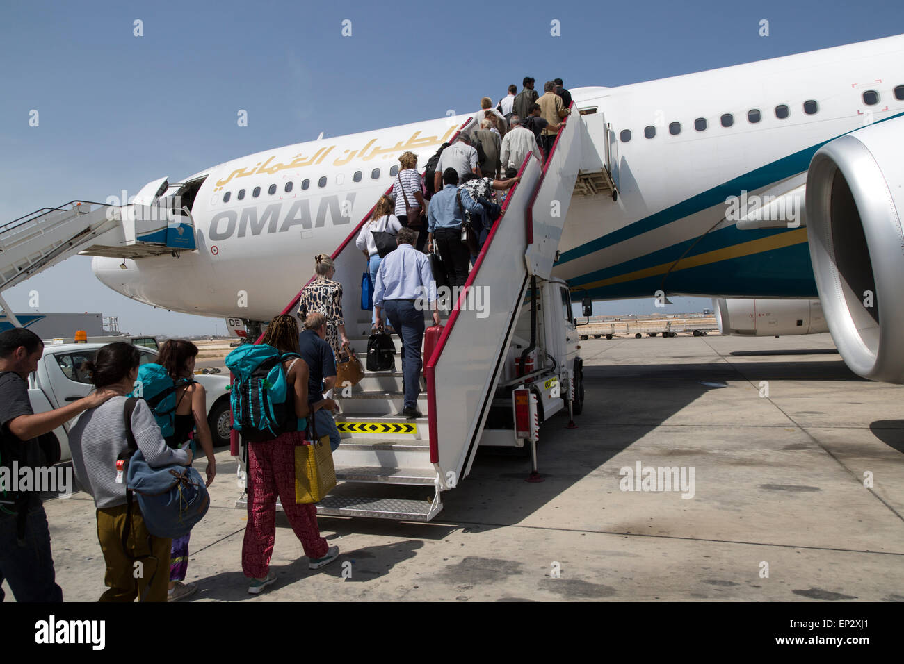 Passengers boarding Oman Airways plane, Seeb International Airport, Muscat, Oman - Stock Image