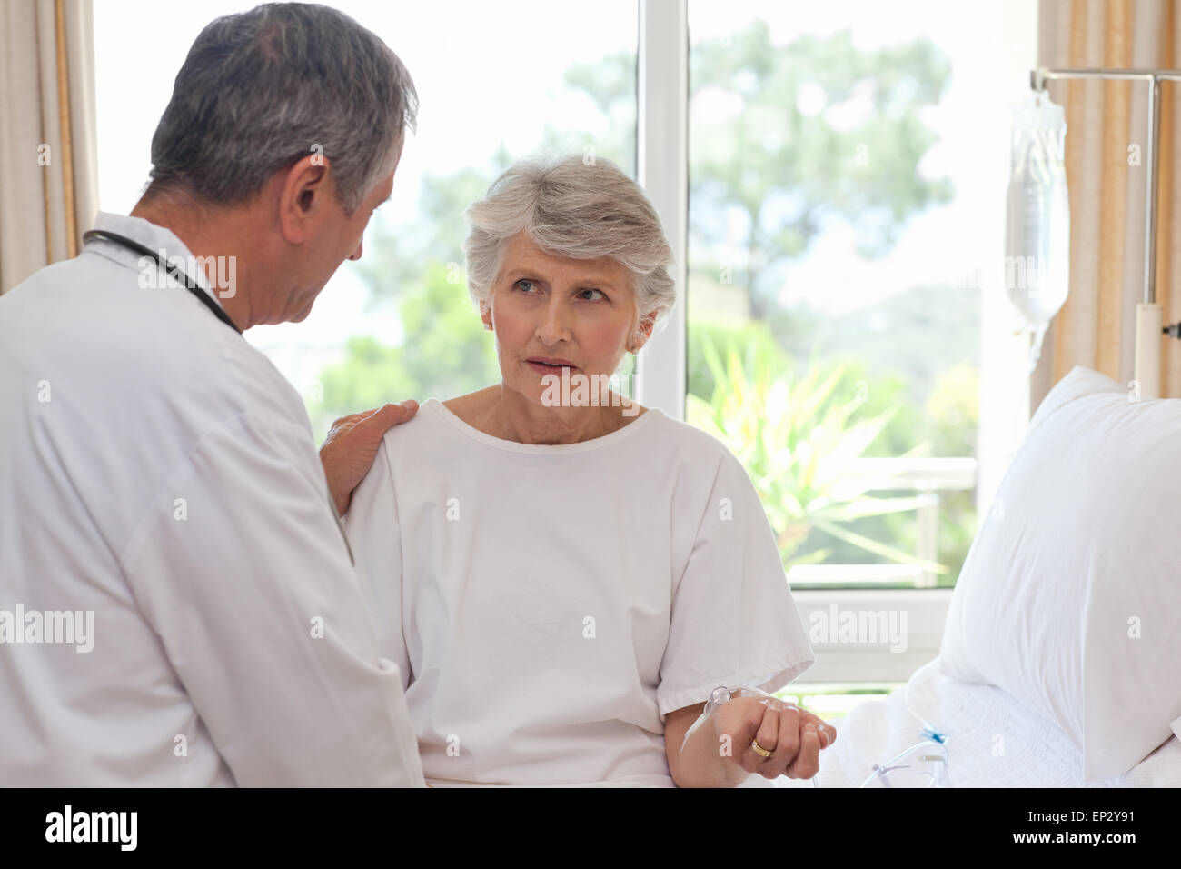 Mature doctor with his patient - Stock Image