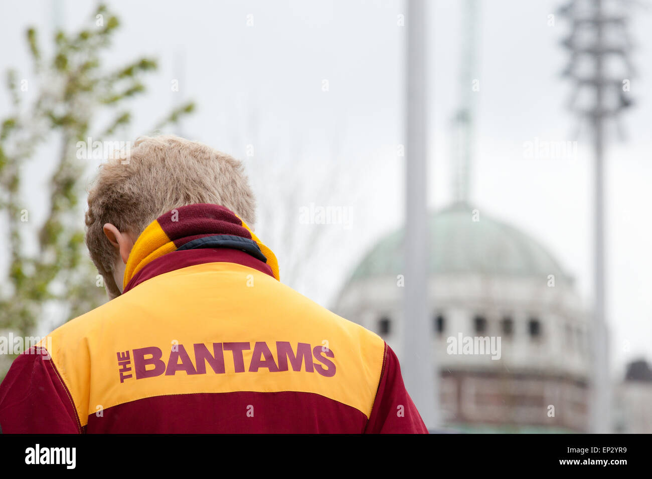 A young Bantams fan pays his respects to those lost in the Bradford City fire disaster of 1986 during the 2013 memorial - Stock Image