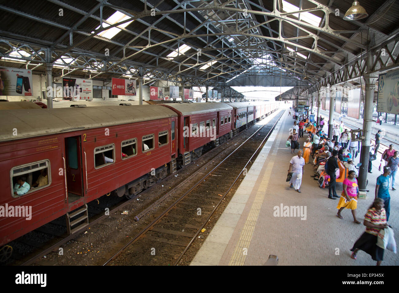 Train platform people inside Fort railway station, Colombo, Sri Lanka, Asia - Stock Image
