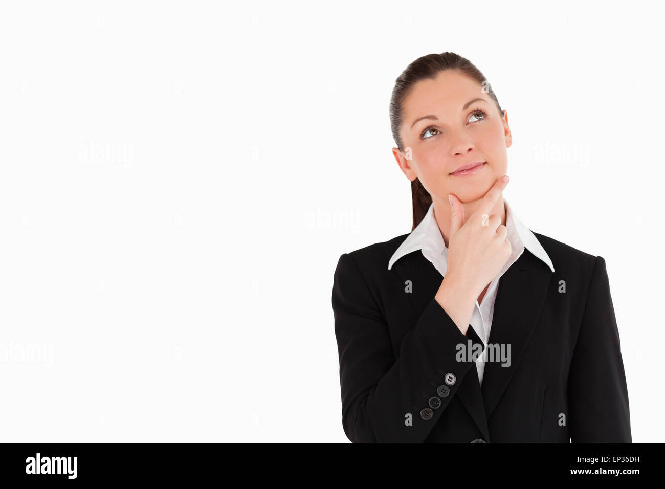 Charming woman in suit posing - Stock Image
