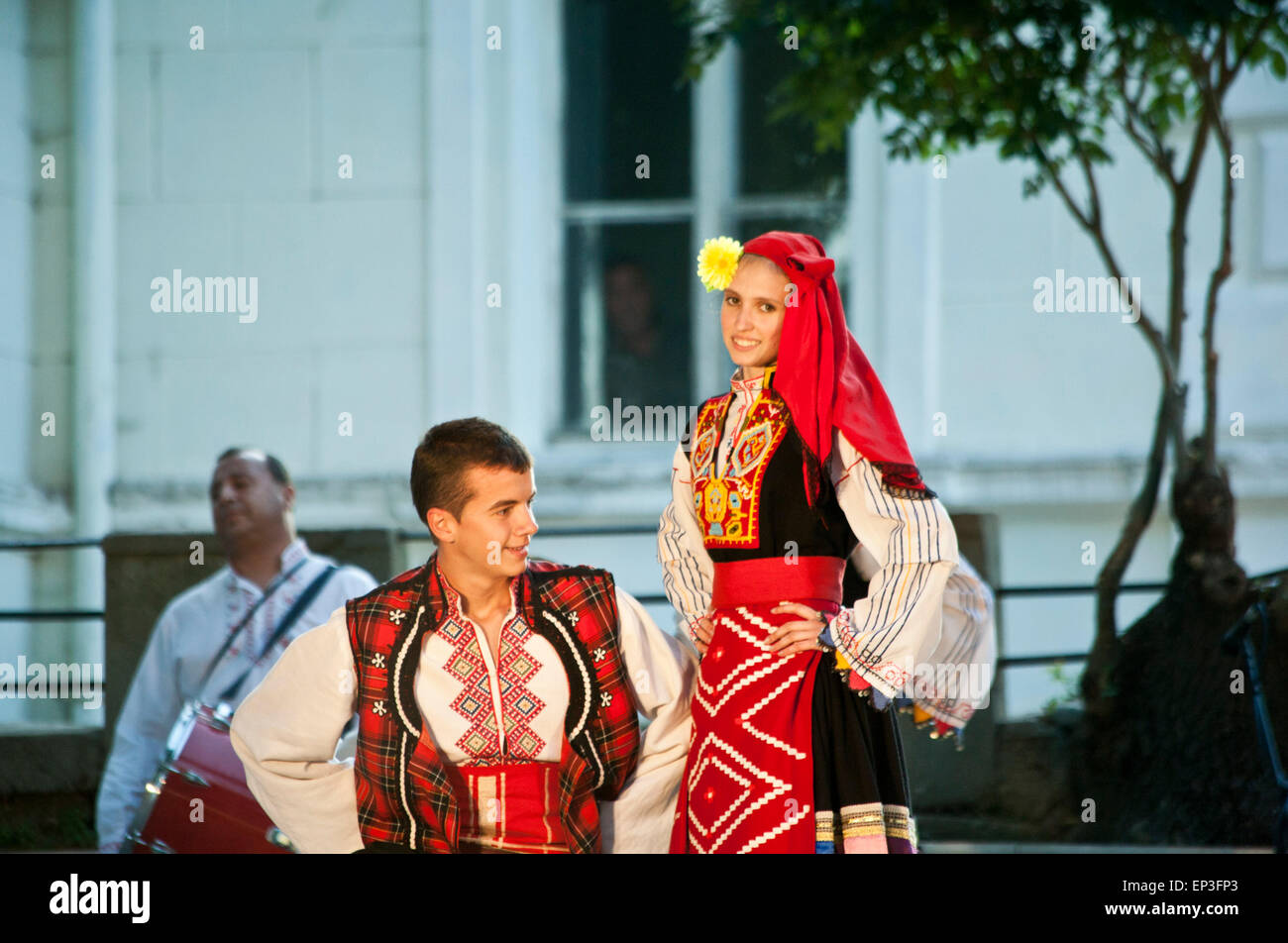 A young couple performing a traditional song and dance in Vidin in Bulgaria. - Stock Image