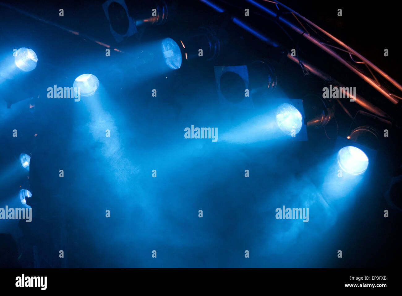 Several blue stage lights in the dark - Stock Image
