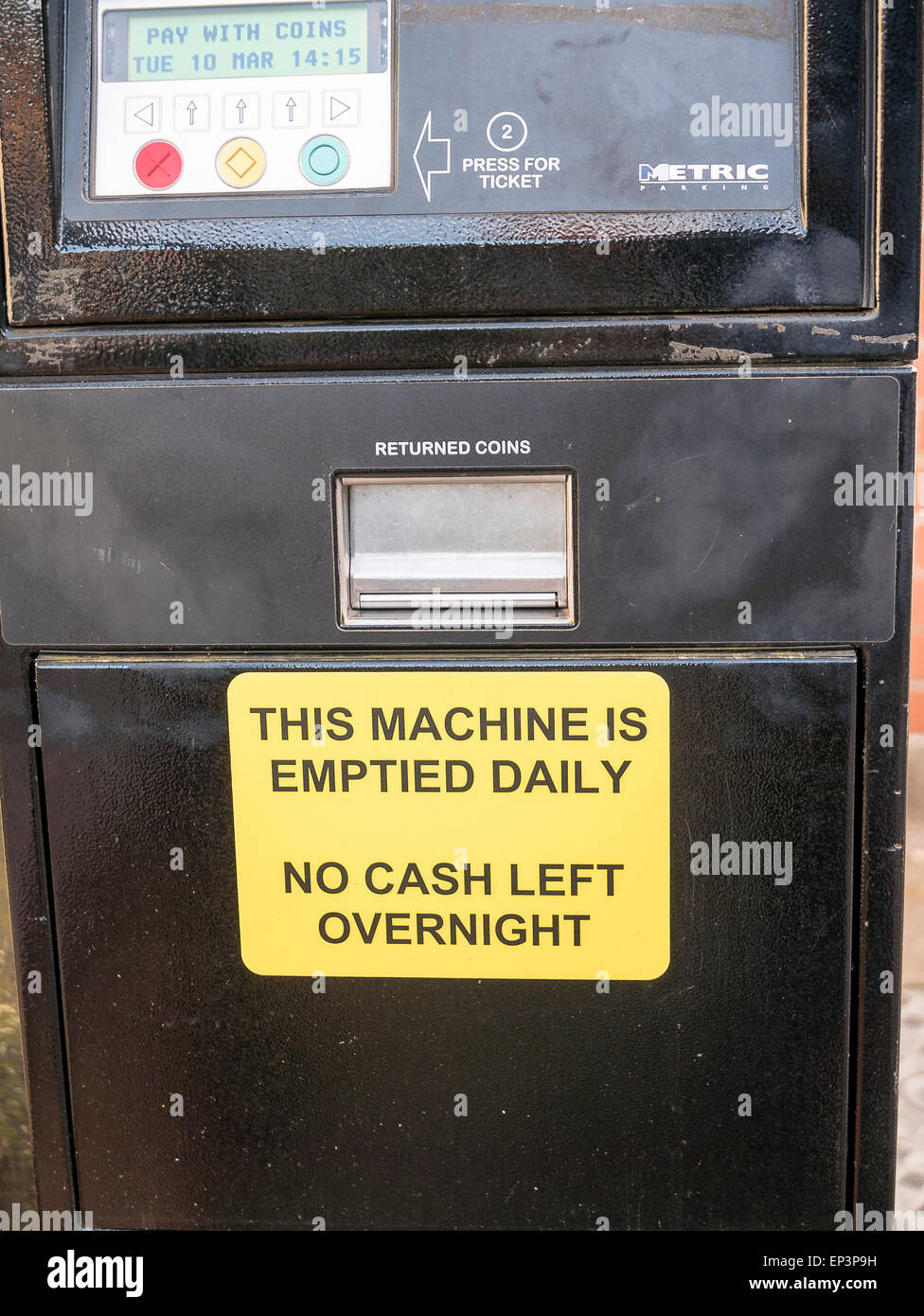 British parking meter with warning notice to prevent out-of-hours theft - Stock Image