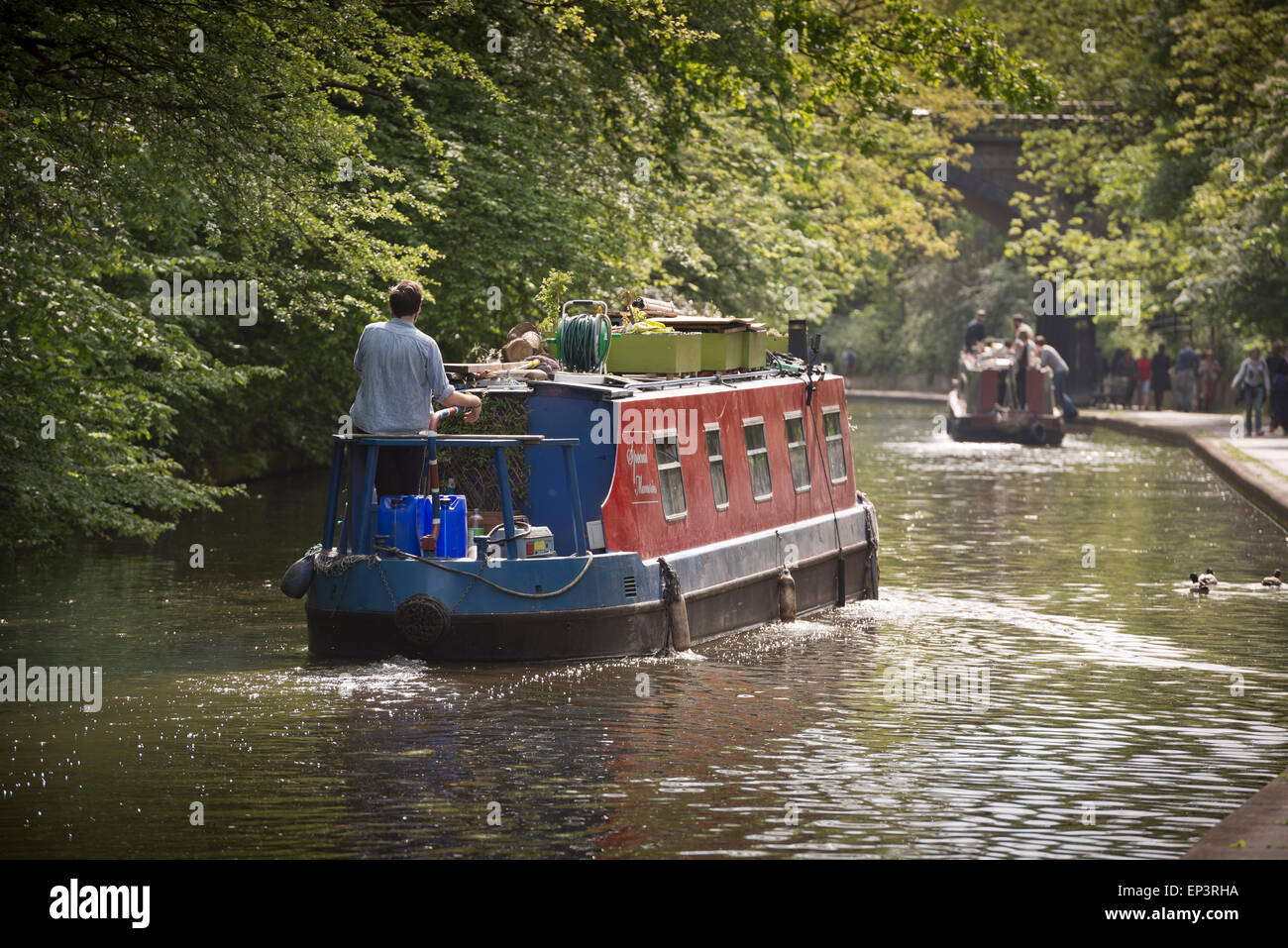 Narrow boats cruising on the Regent's Canal in London - Stock Image