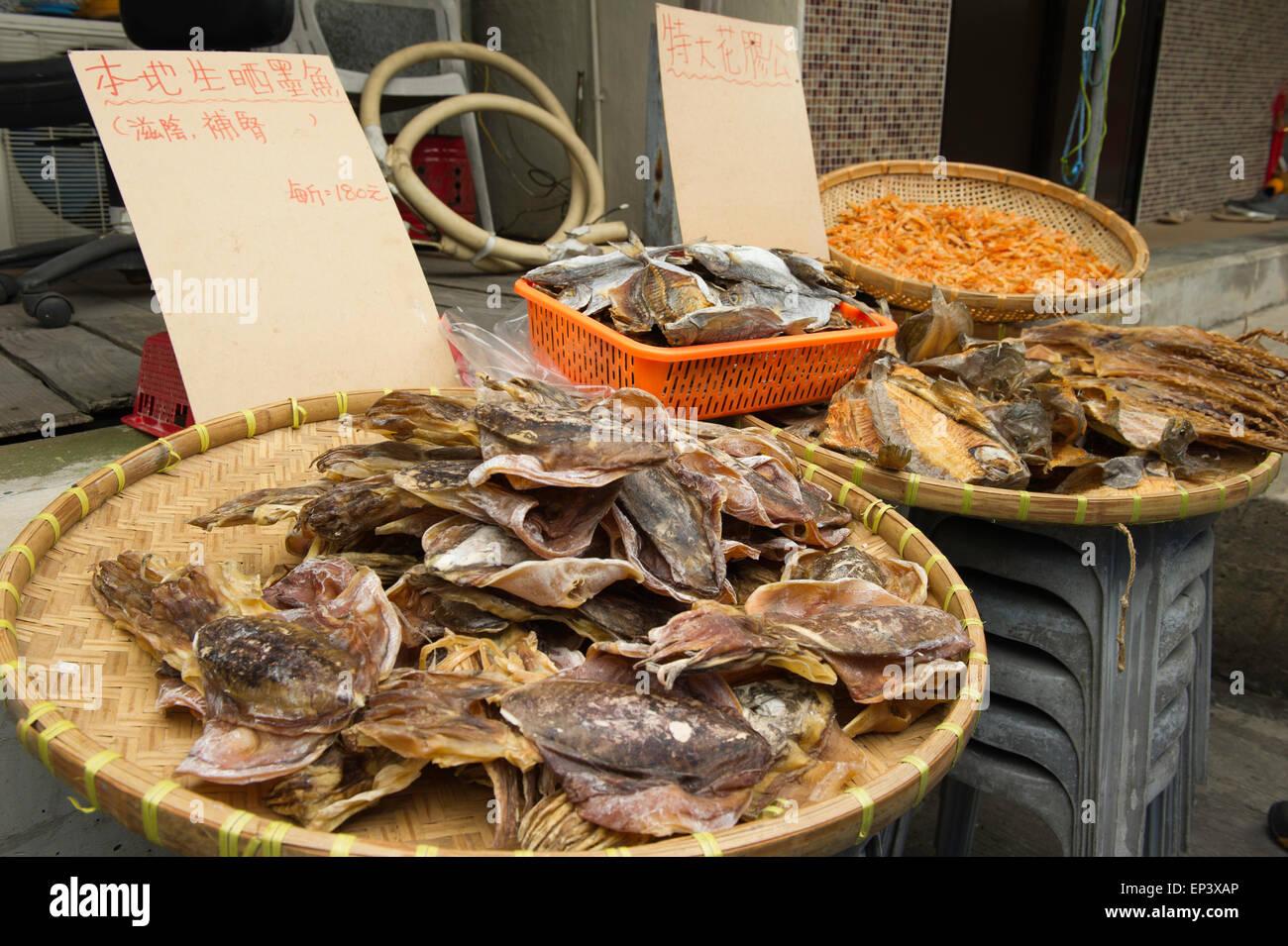 Dried fish at an outdoor street market, Tai O fishing village located on Lantau Island, Hong Kong - Stock Image