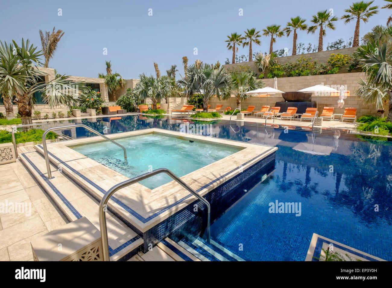 Swimming pool at new luxury  Four Seasons Hotel Bahrain Bay in Manama Kingdom of Bahrain - Stock Image