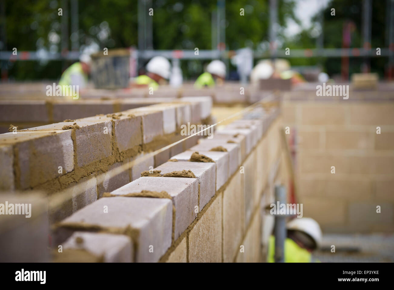 Brick wall being constructed on a building site in London - Stock Image